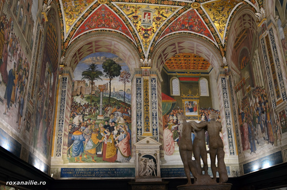 Fresce incredibile pe pereții Bibliotecii Picollomino și statuia celor trei grații